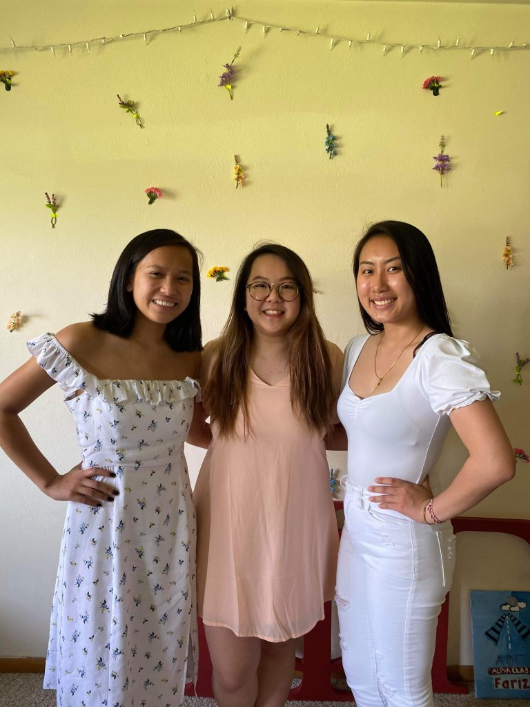 3 Sisters standing together